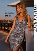 Leopardmönstrad klänning med wrapdetaljer