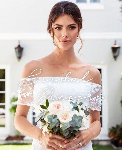 Shoppa brudklänningar i spets