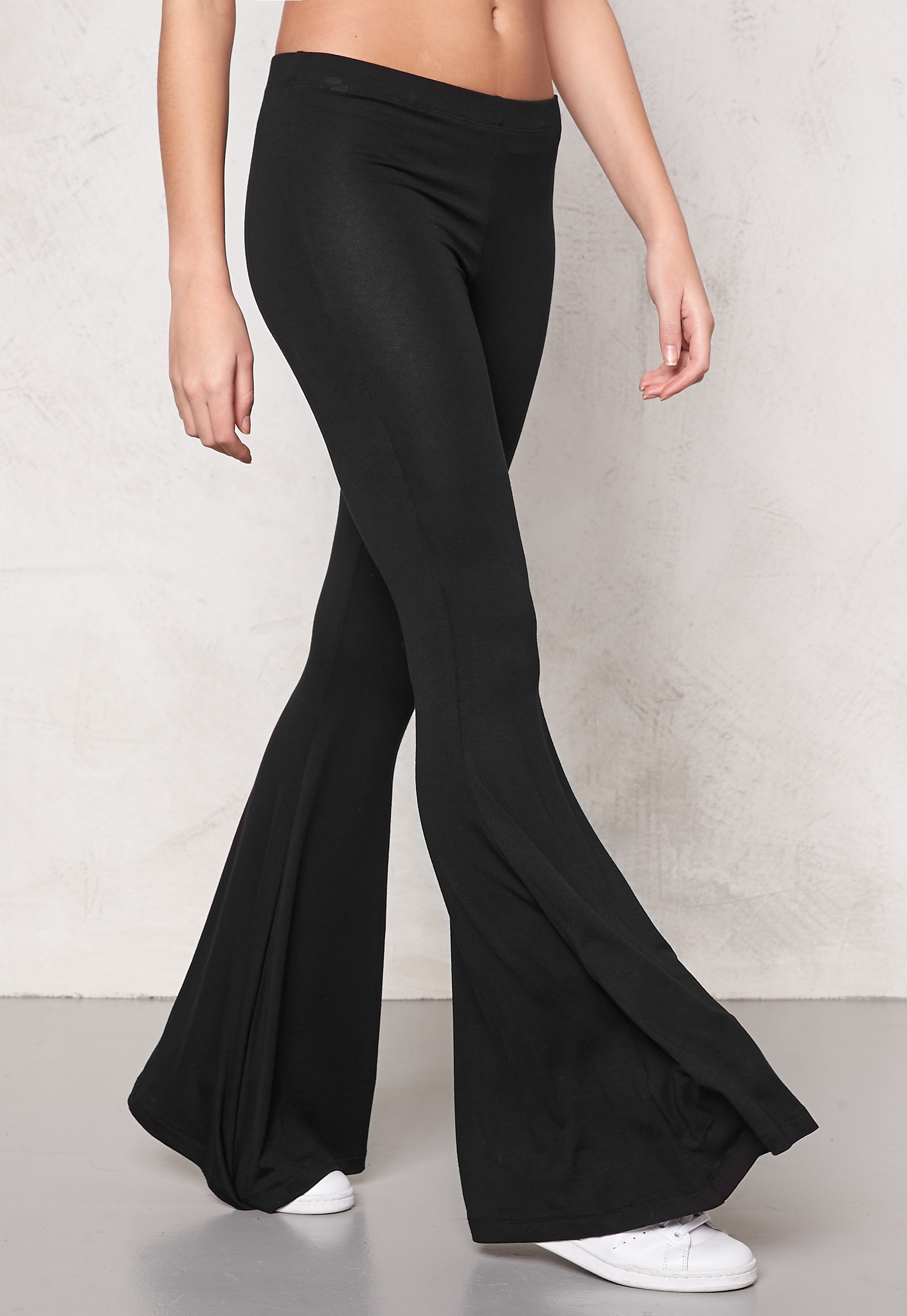Buy flared high-waist trousers - Black at $ at luxurycheckout. Similar products are available.