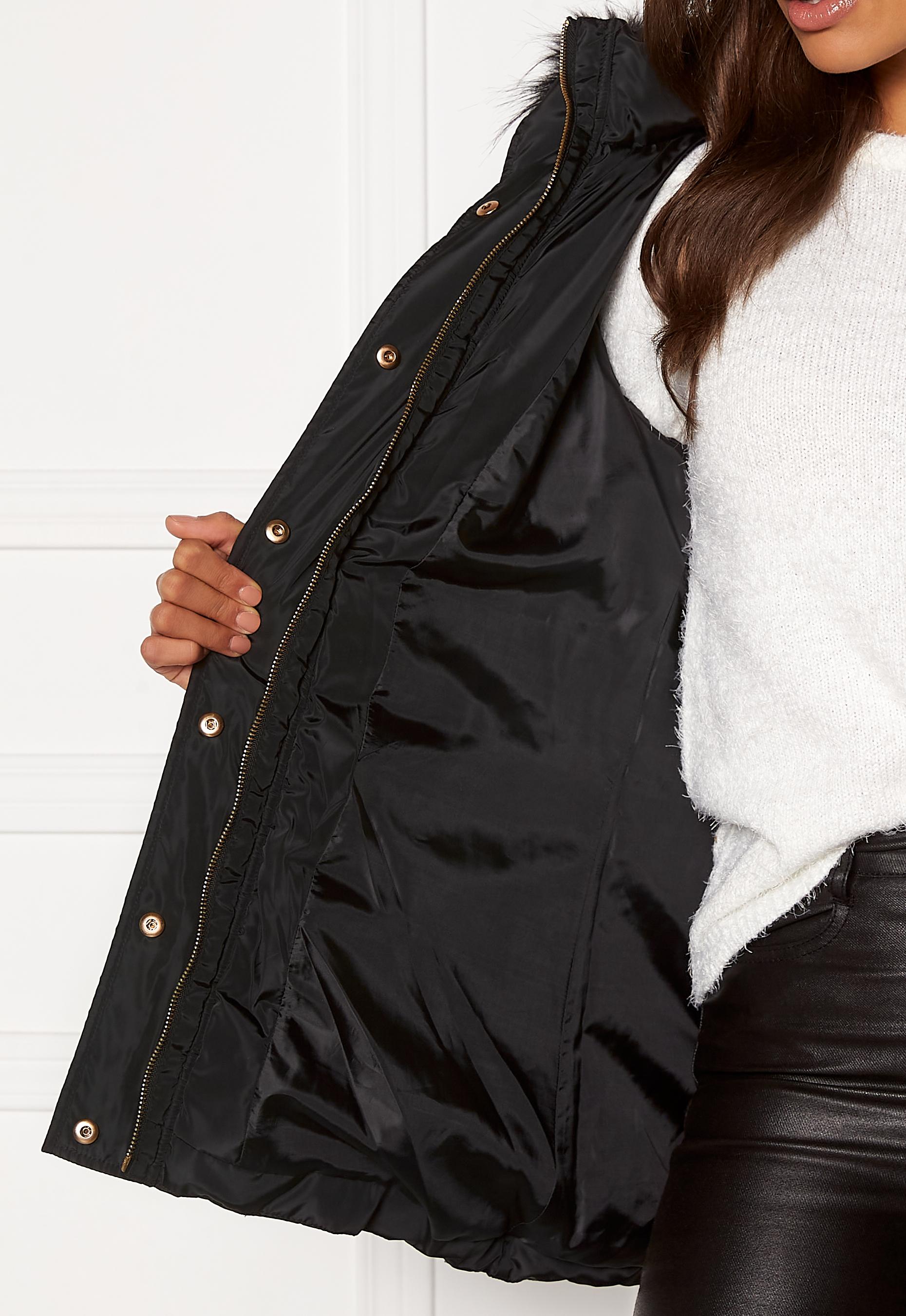 Jacka med dekorativ knappslå