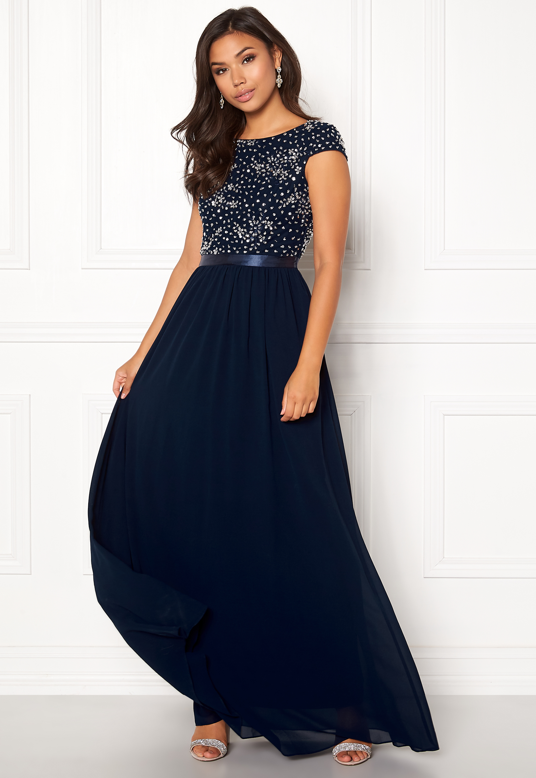 0bce4240 Deep V Neck Metallic Dress Gold. CHIARA FORTHI. Viviere Sparkling Gown  Midnight Blue. ZETTERBERG COUTURE. Stella Dress Ivory/Nude